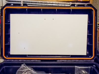 Whiteboard in position.  Holes are for mounting speaker and radio faceplate.