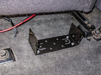 Radio bracket screwed down to the floor