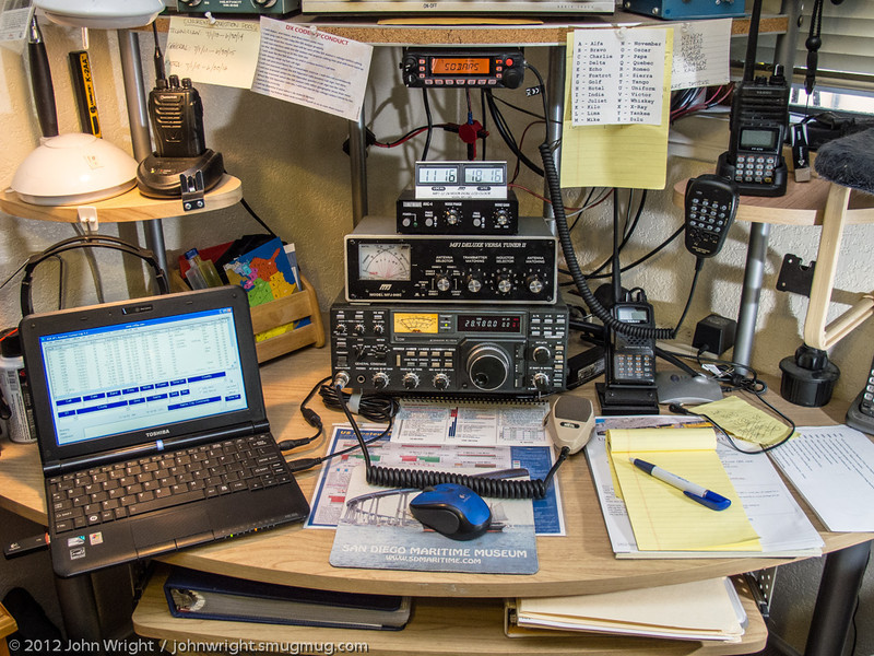 Updated operating station:  Icom IC 751A, MFJ 949-C antenna tuner, TimeWave ANC4 noise reduction box, MFJ Dual Reading Clock.  Also shown are Wouxun KG-UVA1, Yaesu FT-270 and FT-60 HTs, a Yaesu FT-7900 Dual Band transciever and a Toshiba NB 305 netbook for logging and eventually PSK-31.