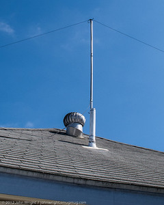 G5RV antenna for HF.  Attached to an 8ft aluminum mast which is in turn attached to a vent pipe on the roof.  Antenna is about 20 feet of the ground at the center.
