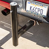 Trailer hitch flagpole holder mounted on the truck