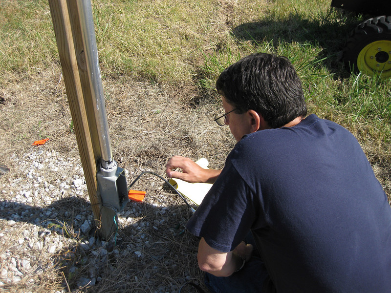 Joel is measuring sensitivity of impedance to radial system (add more until response does not change by more than a few percent) and checking to see if the coil and resistor chosen remove the capacitive reactance (short antenna) and raise the resistive component to match the 75 Ohm cable tv coax (read CHEAP CHEAP CHEAP and plentiful)