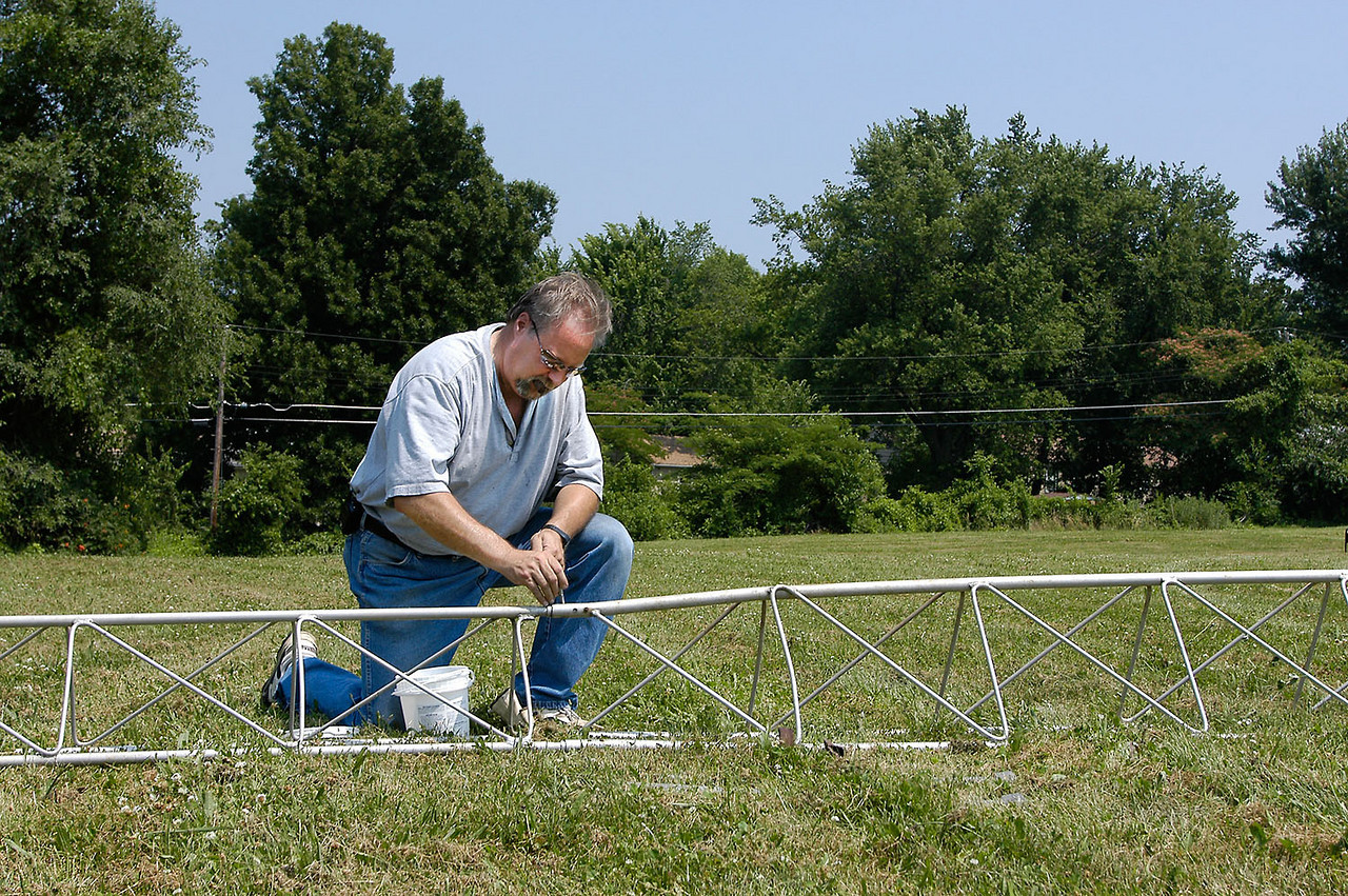 KC0ELZ working on the CW tower.  - <i>Friday, mid-day</i>