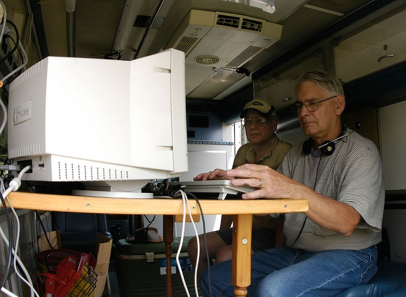 K0OU at the helm of the CW station while W0FEN looks on.<i> - Saturday, evening</i>