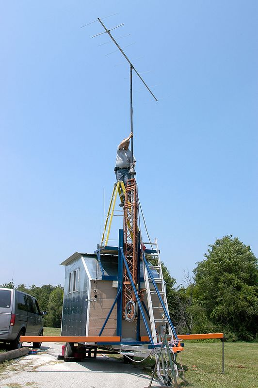 KC0DDZ mounting the mast in the UHF/VHF station tower. - <i>Friday, mid-day</i>