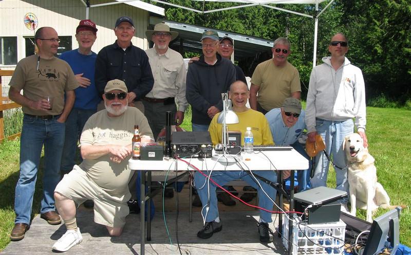"Sunday morning crew of the RCR - ""gang"", before take down on Sunday:<br /> front row from left:<br /> Rick K7LOG, Howard W1HMB, John K7RLD<br /> back row:<br /> David W7CF, Mark KB7N, Bill W7GKF, Grant KZ1W, Herb W7ZF, Bo N7BK, Steve W7QC, Doug AC7T, Chumley"