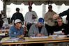 Paul June, Ron Snow, Chris Hauser supervising checkin