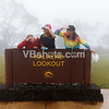 Laura Ratto, Tina Spotts, and Julie Chan straining to see something through the fog at Kalalau Lookout, Waimea Canyon.