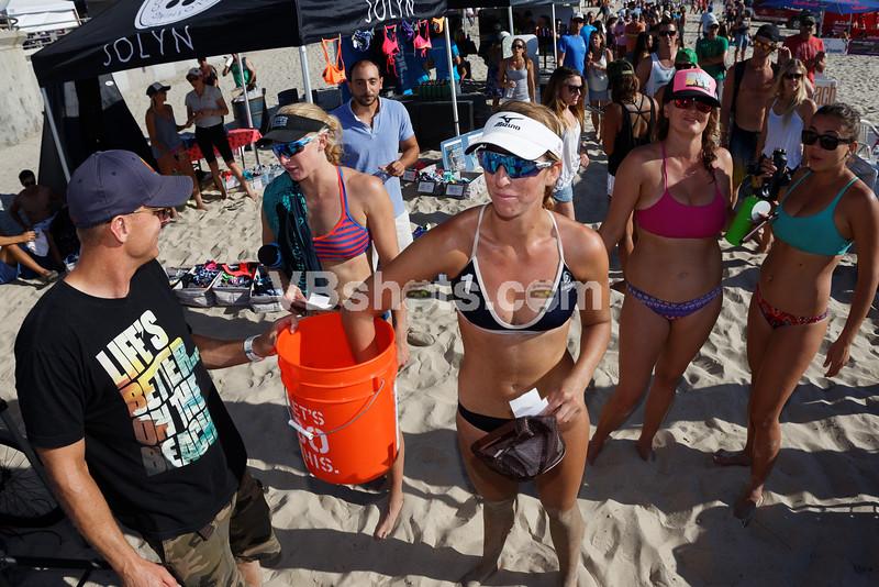 Kelley Larsen pulls the winning raffle ticket for a beach cruiser