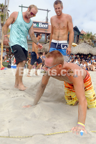 Paul McDonald kicks sand on Todd Shimp