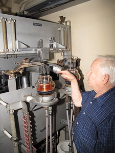 Don Dashney (VE3RM) checks out a tube of a de-commissioned short wave transmitter.
