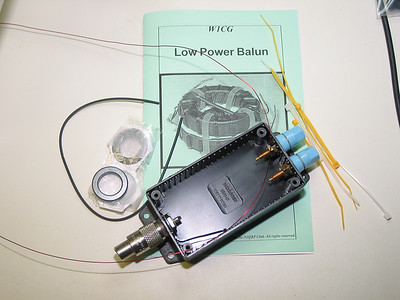 """This is W1CG balun kit.  For more info see http://www.njqrp.org/balun/.  The enclosure and hardware came from a local store. The """"Kit"""" is no longer available but parts shouldn't be too hard to come by. Download the manual and build one: http://www.njqrp.org/balun/Balun%20Manual%20-%20final.pdf"""