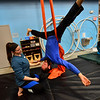 KRISTOPHER RADDER — BRATTLEBORO REFORMER<br /> Gabrielle Leo, a coach at New England Center of Circus Arts, helps Xaviar Duke, from Townshend, Vt., on the silks during an open class on Monday, Feb. 17, 2020.