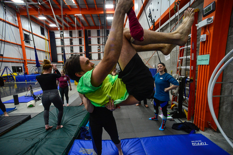 KRISTOPHER RADDER — BRATTLEBORO REFORMER<br /> Katherine Rodge, a coach at New England Center of Circus Arts, helps Chris Mays, a reporter from the Brattleboro Reformer, up onto the trapeze during an open class on Monday, Feb. 17, 2020.