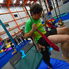KRISTOPHER RADDER — BRATTLEBORO REFORMER<br /> Chris Mays, a reporter from the Brattleboro Reformer, sits on the trapeze during an open class at the New England Center of Circus Arts on Monday, Feb. 17, 2020.