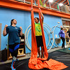 KRISTOPHER RADDER — BRATTLEBORO REFORMER<br /> Gabrielle Leo, a coach at New England Center of Circus Arts, helps Chris Mays, a reporter from the Brattleboro Reformer, on the silks during an open class on Monday, Feb. 17, 2020.