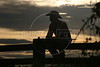 A cowboy sits on a fence in Espigao D'oeste in Brazil's Amazonian state of, Rondonia, Mar. 18, 2006.(AustralFoto/Douglas Engle)