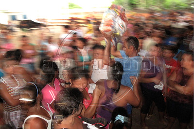 "Residents of Caapiranga, which is only accessable by river or air, get ""basic baskets"" of food supplies in the Brazilian state of Amazonas, Nov. 4, 2010. The low river levels broke the previous drought record which was set only 5 years ago, a frequency which environmental groups say are a direct result of deforestation and global warming. (Australfoto/Douglas Engle)"