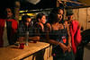 Women at a bar during the evening in a virtually instant town in the remote Amazon forest, about 80km from Apui in the Brazilian state of Amazonas, Feb. 1, 2007. Thousands of people have created the town, including prostitutes, bars and pharmacies, in a mobilization rivaling that of a military operation to dig for gold in the region, discovered in Dec. 2006. The environment is not much of a concern as trees are felled and pits are dug by people from all over Brazil and from all walks of life. Most simply say that some deforestation in the immense amazon it is the price to pay for Brazilians to exploit their nation's riches. (AustralFoto/Douglas Engle)