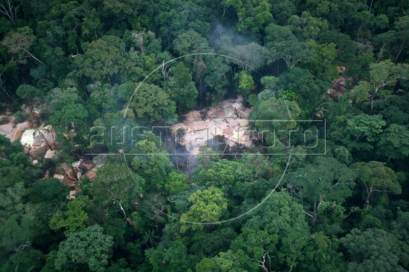 A view of an open-air gold mine, about 80km from Apui in the Brazilian state of Amazonas, Feb. 5, 2007. Thousands of people have created a virtually instant town in the remote Amazon forest to dig for gold in the region, discovered in Dec. 2006. The environment is not much of a concern as trees are felled and pits are dug by people from all over Brazil and from all walks of life. Most simply say that some deforestation in the immense amazon it is the price to pay for Brazilians to exploit their nation's riches.(AustralFoto/Douglas Engle)