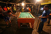 Miners shoot pool at a bar in a mining villageabout 80km from Apui in the Brazilian state of Amazonas, Feb. 1, 2007. Thousands of people have created the town, including prostitutes, bars and pharmacies, in a mobilization rivaling that of a military operation to dig for gold in the region, discovered in Dec. 2006. The environment is not much of a concern as trees are felled and pits are dug by people from all over Brazil and from all walks of life. Most simply say that some deforestation in the immense amazon it is the price to pay for Brazilians to exploit their nation's riches.(AustralFoto/Douglas Engle)