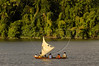 A wind-powered canoe navegates a channel of the Amazon river near Vila Progresso in the Balique island arquipelago of the Amazon river delta of Brazil's northern Amapa state, Dec. 6, 2004. The village is served every two months by a boat carrying some 40 people from the justice department and other state agencies who travel 12 hours from the state capital Macapa, in an effort to include the population in the state system. It is a unique Brazilian solution to the immense geography of the Amazon, where roads do not exist and travel is costly and slow. People who once lived their whole lives with no records of birth, mariage, death, or even ID cards, are no longer forgotton by the state in this real life waterworld. (AustralFoto/Douglas Engle)