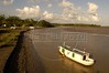 A man pushes his boat through low tide near Livramento in a channel of the Amazon River in the Balique island arquipelago of the Amazon river delta of Brazil's northern Amapa state, Dec. 6, 2004. The village is served every two months by a boat carrying some 40 people from the justice department and other state agencies who travel 12 hours from the state capital Macapa, in an effort to include the population in the state system. It is a unique Brazilian solution to the immense geography of the Amazon, where roads do not exist and travel is costly and slow. People who once lived their whole lives with no records of birth, mariage, death, or even ID cards, are no longer forgotton by the state in this real life waterworld. (AustralFoto/Douglas Engle)