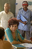 Judge Sueli Pini listens during a case in the village of Livramento in the Balique island arquipelago of the Amazon river delta of Brazil's northern Amapa state. Every two months some 40 people from the justice department and other state agencies travel from the state capital Macapa down the Amazon river in a mission to bring state services to residents of the remote region. It is a unique Brazilian solution to the immense geography of the Amazon, where roads do not exist and travel is costly and slow. People who once lived their whole lives with no records of birth, mariage, death, or even ID cards, are no longer forgotton by the state in this real life waterworld. (AustralFoto/Douglas Engle)