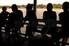 """Residents of the Balique island arquipelago of the Amazon river delta wait to be attended aboard """"Tribuna,"""" a courtroom boat, in Brazil's northern Amapa state. Every two months some 40 people from the justice department and other state agencies travel from the state capital Macapa down the Amazon river in a mission to bring state services to residents of the remote region. It is a unique Brazilian solution to the immense geography of the Amazon, where roads do not exist and travel is costly and slow. People who once lived their whole lives with no records of birth, mariage, death, or even ID cards, are no longer forgotton by the state in this real life waterworld. (AustralFoto/Douglas Engle)"""