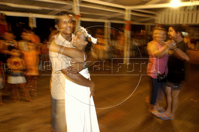 Edielco Lopes Marques, left, and Marcinete da Silva Araujo dance after  getting married during a visit by Amapa state justice Sueli Pini in the village of Livramentoin the Balique island arquipelago of the Amazon river delta of Brazil's northern Amapa state. Every two months some 40 people from the justice department and other state agencies travel from the state capital Macapa down the Amazon river in a mission to bring state services to residents of the remote region. It is a unique Brazilian solution to the immense geography of the Amazon, where roads do not exist and travel is costly and slow. People who once lived their whole lives with no records of birth, mariage, death, or even ID cards, are no longer forgotton by the state in this real life waterworld. (AustralFoto/Douglas Engle)