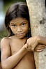 Jaqueline, a residents of Vila Progresso in the Balique island arquipelago of the Amazon river delta of Brazil's northern Amapa state, Dec. 6, 2004. The village is served every two months by a boat carrying some 40 people from the justice department and other state agencies who travel 12 hours from the state capital Macapa, in an effort to include the population in the state system. It is a unique Brazilian solution to the immense geography of the Amazon, where roads do not exist and travel is costly and slow. People who once lived their whole lives with no records of birth, mariage, death, or even ID cards, are no longer forgotton by the state in this real life waterworld. (AustralFoto/Douglas Engle)
