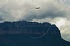 A Brazilian Air Force plane flies near Mount Roraima, in the Brazilian Amazonian state of Roraima, in northern Brazil. The mountain also forms the Brazilian border with Venezuela and Guyana. (Australfoto/Douglas Engle)