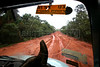 A view of the BR163 highway, from inside a cargo truck, which leads to Castelo dos Sonhos (the Castle of Dreams), an isolated, dusty (and muddy) town in the northern state of Par‡ that until recently was at the centre of Brazil's illegal logging trade.  The tale of Castelo dos Sonhos' sudden economic bust is, in many ways, the tale of the Brazilian government's success in trying to protect the world's largest rainforest. Until recently, when authorities began clamping down on illegal deforestation in the region, the town was at the centre of a timber boom as lucrative as it was illicit. (Australfoto/Douglas Engle)
