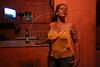 Marina Ketts stands in her bar in the red-light district of Castelo dos Sonhos (the Castle of Dreams), an isolated, dusty town in the northern state of Par‡ that until recently was at the centre of Brazil's illegal logging trade.  The tale of Castelo dos Sonhos' sudden economic bust is, in many ways, the tale of the Brazilian government's success in trying to protect the world's largest rainforest. Until recently, when authorities began clamping down on illegal deforestation in the region, the town was at the centre of a timber boom as lucrative as it was illicit. (Australfoto/Douglas Engle)