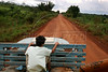 A young man hitches a ride on a cargo truck on  the BR163 highway which leads to Castelo dos Sonhos (the Castle of Dreams), an isolated, dusty (and muddy) town in the northern state of Par‡ that until recently was at the centre of Brazil's illegal logging trade.  The tale of Castelo dos Sonhos' sudden economic bust is, in many ways, the tale of the Brazilian government's success in trying to protect the world's largest rainforest. Until recently, when authorities began clamping down on illegal deforestation in the region, the town was at the centre of a timber boom as lucrative as it was illicit. (Australfoto/Douglas Engle)