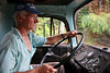 A truck driver on the controversial BR163 highway which leads to Castelo dos Sonhos (the Castle of Dreams), an isolated, dusty (and muddy) town in the northern state of Par‡ that until recently was at the centre of Brazil's illegal logging trade.  The tale of Castelo dos Sonhos' sudden economic bust is, in many ways, the tale of the Brazilian government's success in trying to protect the world's largest rainforest. Until recently, when authorities began clamping down on illegal deforestation in the region, the town was at the centre of a timber boom as lucrative as it was illicit. (Australfoto/Douglas Engle)