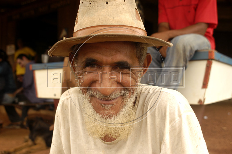 """A man at a restaurant in the """"Terra do Meio"""" or Middle Lands, in the municipality of Sao Felix do Xingu in Brazil's Amazonian state of Para. Named for the area between the Xingu and Iriri Rivers, the 29,343 sq. mile area (slightly smaller than Maine or Scotland) lies in the path of progress as cattle ranches encroach from the east and big business soy advances from the south. illegal logging, labor, land-grabbing and human rights abuses in the area are not uncommon. Simple people, looking for opportunity to have some cheap land, are migrating to the reagion. Much Like the favelas of Rio de Janeiro, which were not officially included on city maps until the mid-1990s, the Middle Land is also a species of autonomous zone - a black hole of information and uncertainty over which Brazilian authorities in reality have little control. (AustralFoto/Douglas Engle)"""