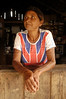 """Maria de Jesus, 52, wears a Union Jack shirt at her small shop n the """"Terra do Meio"""" or Middle Lands, in the municipality of Sao Felix do Xingu in Brazil's Amazonian state of Para. Named for the area between the Xingu and Iriri Rivers, the 29,343 sq. mile area (slightly smaller than Maine or Scotland) lies in the path of progress as cattle ranches encroach from the east and big business soy advances from the south. illegal logging, labor, land-grabbing and human rights abuses in the area are not uncommon. Simple people, looking for opportunity to have some cheap land, are migrating to the reagion. Much Like the favelas of Rio de Janeiro, which were not officially included on city maps until the mid-1990s, the Middle Land is also a species of autonomous zone - a black hole of information and uncertainty over which Brazilian authorities in reality have little control. (AustralFoto/Douglas Engle)"""