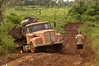 "Like nature's last revenge, a timber truck get stuck in the mud In the ""Terra do Meio"" or Middle Lands, in the municipality of Sao Felix do Xingu in Brazil's Amazonian state of Para. Named for the area between the Xingu and Iriri Rivers, the 29,343 sq. mile area (slightly smaller than Maine or Scotland) lies in the path of progress as cattle ranches encroach from the east and big business soy advances from the south. illegal logging, labor, land-grabbing and human rights abuses in the area are not uncommon. Simple people, looking for opportunity to have some cheap land, are migrating to the reagion. Much Like the favelas of Rio de Janeiro, which were not officially included on city maps until the mid-1990s, the Middle Land is also a species of autonomous zone - a black hole of information and uncertainty over which Brazilian authorities in reality have little control. (AustralFoto/Douglas Engle)"