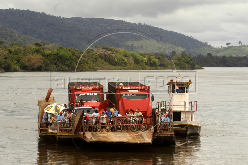 "A ferry brings passengers and cargo across the Xingu River from the ""Terra do Meio"" or Middle Lands, in the municipality of Sao Felix do Xingu in Brazil's Amazonian state of Para.Named for the area between the Xingu and Iriri Rivers, the 29,343 sq. mile area (slightly smaller than Maine or Scotland) lies in the path of progress as cattle ranches encroach from the east and big business soy advances from the south. illegal logging, labor, land-grabbing and human rights abuses in the area are not uncommon. Simple people, looking for opportunity to have some cheap land, are migrating to the reagion. Much Like the favelas of Rio de Janeiro, which were not officially included on city maps until the mid-1990s, the Middle Land is also a species of autonomous zone - a black hole of information and uncertainty over which Brazilian authorities in reality have little control. (AustralFoto/Douglas Engle)"