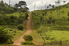 """A view of the unofficial """"Trans Iriri"""" highway which crosses the """"Terra do Meio"""" or Middle Lands, in the municipality of Sao Felix do Xingu in Brazil's Amazonian state of Para. Named for the area between the Xingu and Iriri Rivers, the 29,343 sq. mile area (slightly smaller than Maine or Scotland) lies in the path of progress as cattle ranches encroach from the east and big business soy advances from the south. illegal logging, labor, land-grabbing and human rights abuses in the area are not uncommon. Simple people, looking for opportunity to have some cheap land, are migrating to the reagion. Much Like the favelas of Rio de Janeiro, which were not officially included on city maps until the mid-1990s, the Middle Land is also a species of autonomous zone - a black hole of information and uncertainty over which Brazilian authorities in reality have little control. (AustralFoto/Douglas Engle)"""