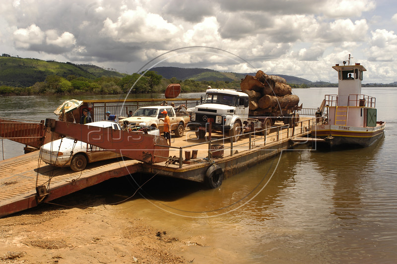 "A log truck arrives from the ""Terra do Meio"" or Middle Lands, on a ferry in the XIngu River in the municipality of Sao Felix do Xingu in Brazil's Amazonian state of Para. Named for the area between the Xingu and Iriri Rivers, the 29,343 sq. mile area (slightly smaller than Maine or Scotland) lies in the path of progress as cattle ranches encroach from the east and big business soy advances from the south. illegal logging, labor, land-grabbing and human rights abuses in the area are not uncommon. Simple people, looking for opportunity to have some cheap land, are migrating to the reagion. Much Like the favelas of Rio de Janeiro, which were not officially included on city maps until the mid-1990s, the Middle Land is also a species of autonomous zone - a black hole of information and uncertainty over which Brazilian authorities in reality have little control. (AustralFoto/Douglas Engle)"