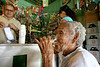 Olinda Pereira Branco, 95, drinks beers at a local shop in Fordlandia, a former factory town created by the Ford Motor Company on the banks of the Tapaj—os River, September 6, 2005. Branco, who worked as a nanny and maid for Ford executives, is one of the few residents who remember the Americans. Deep in the Amazon forest, 12 hours by boat from the regional capital of Santarem in Brazil's Par‡a state, the rubber plantation and processing factory is now abandoned to the rain-forest, an aging memorial to American ideals and to the Brazilian reality. It almost seems like time has stopped in Fordlandia, or better yet, time has passed it by. In typical american style, it was organized and efficient, an idea admired by many Brazilians, and perhaps more so by residents of the untamed Amazon. But It is an idea hard to implement in the wilds of the amazon. Some might also say that it is also a typical American style the way Ford came here and tried to implement something with little knowledge of the local customs or terrain. From 1928 to 1945, Ford came tried to take control of his rubber supply, one of the most important products of the rainforest. After only 17 years the company admitted defeat and retreated from the forest. (AustralFoto/Douglas Engle)