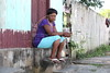 A Haitian woman waits outside a small hotel in Brasileia, in Brazil's Amazonian state of Acre, on the border with Bolivia. Hundreds, if not thousands, of Haitians are showing up in Brazil - after an odyssey through Equador, Peru and Bolivia - with hopes of gaining residency as refugees in South America's largest nation.  (Douglas Engle/Australfoto)
