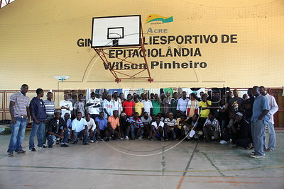 Haitian immigrants wait in a gymnasium in Epitaciolandia in Brazil's Amazonian state of Acre, on the border with Bolivia. Hundreds, if not thousands, of Haitians are showing up in Brazil - after an odyssey through Equador, Peru and Bolivia - with hopes of gaining residency as refugees in South America's largest nation. The gymnasium serves as a holding center and shelter until the legal situation of the immigrants is resolved. (Douglas Engle/Australfoto)