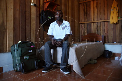 Baptiste Suppler, a would-be Haitian immigrant to Brazil, from Gonaives, Haiti, sits in his hotel room in the tiny Peruvian town of Inapari, on the border with Brazil - amazingly enough on an street called Brazil Ave. Hundreds, if not thousands, of Haitians are showing up in Brazil - after an odyssey through Equador, Peru and Bolivia - with hopes of gaining residency as refugees in South America's largest nation.  (Douglas Engle/Australfoto)