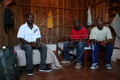 Baptiste Suppler, a would-be Haitian immigrant to Brazil, from Gonaives, Haiti, left, sits in his hotel room with other Hatians in the tiny Peruvian town of Inapari, on the border with Brazil - amazingly enough on an street called Brazil Ave. Hundreds, if not thousands, of Haitians are showing up in Brazil - after an odyssey through Equador, Peru and Bolivia - with hopes of gaining residency as refugees in South America's largest nation.  (Douglas Engle/Australfoto)