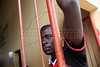 A Haitian immigrant waits in a gymnasium in Epitaciolandia in Brazil's Amazonian state of Acre, on the border with Bolivia. Hundreds, if not thousands, of Haitians are showing up in Brazil - after an odyssey through Equador, Peru and Bolivia - with hopes of gaining residency as refugees in South America's largest nation. The gymnasium serves as a holding center and shelter until the legal situation of the immigrants is resolved. (Douglas Engle/Australfoto)
