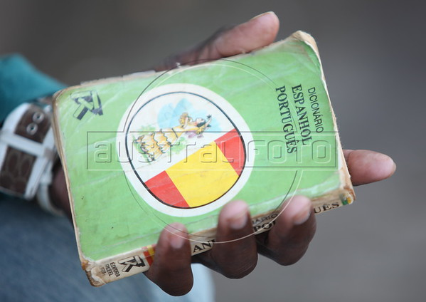 A Haitian immigrant holds a Portuguese-Spanish dictionary outside a small hotel in Brasileia, in Brazil's Amazonian state of Acre, on the border with Bolivia. Hundreds, if not thousands, of Haitians are showing up in Brazil - after an odyssey through Equador, Peru and Bolivia - with hopes of gaining residency as refugees in South America's largest nation. (Douglas Engle/Australfoto)