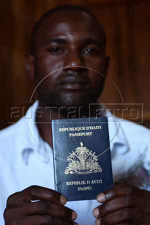 Baptiste Suppler, a would-be Haitian immigrant to Brazil, from Gonaives, Haiti, shows his passport in his hotel room in the tiny Peruvian town of Inapari, on the border with Brazil - amazingly enough on an street called Brazil Ave. Hundreds, if not thousands, of Haitians are showing up in Brazil - after an odyssey through Equador, Peru and Bolivia - with hopes of gaining residency as refugees in South America's largest nation.  (Douglas Engle/Australfoto)